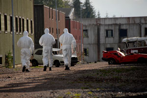 3 men in hazmat suits