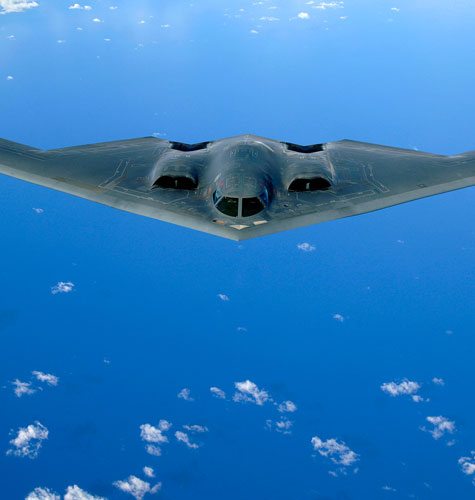 A B-2 Spirit soars after a refueling mission over the Pacific Ocean