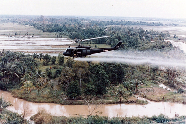 Helicopter Spraying Agent Orange, Source: U.S. Army via WikiMedia Commons