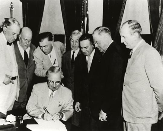 President Truman Signing Atomic Energy Act of 1946